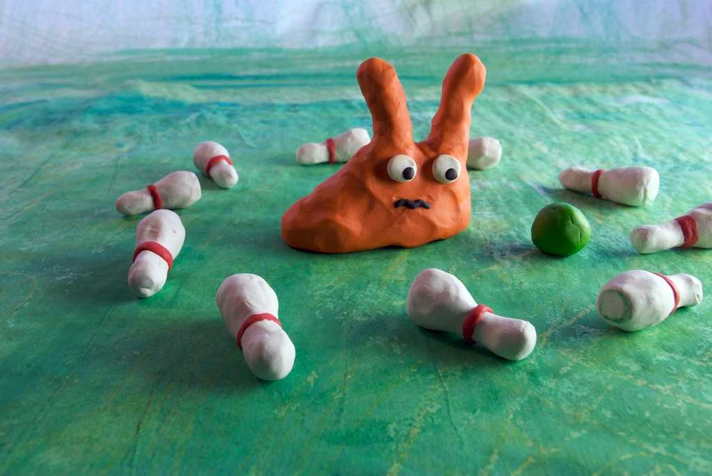 claymation with a cute orange slugs